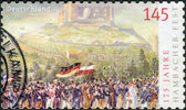 Postage stamp printed in Germany dedicated to the 175th anniversary of the Hambach Festival, shows a Procession to Hambach Castle — Foto Stock
