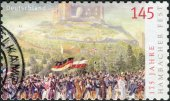 Postage stamp printed in Germany dedicated to the 175th anniversary of the Hambach Festival, shows a Procession to Hambach Castle — Stockfoto