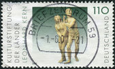Postage stamp printed in Germany, shows The Expulsion from Paradise, sculpture by Leonhard Kern — Stock Photo