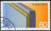 Postage stamp printed in Germany, dedicated to the conservation of energy, shows insulated wall — Stockfoto