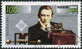 Postage stamp printed in Germany, dedicated to the 100th anniversary of the invention of radio, shows an engineer, physicist and Nobel Prize winner, Guglielmo Marconi — Foto Stock