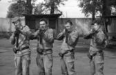 Soldiers posing with guns. Preparations for shooting. Film scan. Large grain — Stock Photo
