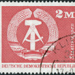 Postage stamp printed in Germany, shows the coat of arms of the German Democratic Republic — Stock Photo #53051227