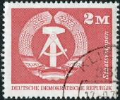Postage stamp printed in Germany, shows the coat of arms of the German Democratic Republic — Stock Photo