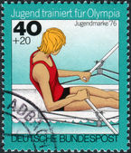 Postage stamp printed in Germany, Issue: Youth training for the Olympics, depicts Rowing, single sculls — Stock Photo