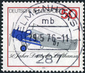 Postage stamp printed in Germany, dedicated to the 50th anniversary of Lufthansa, shows a first all-metal transport aircraft Junkers F.13 — Stock Photo