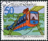 Postage stamp printed in Germany, dedicated to the 75th anniversary of the Wuppertal suspension railroad, is depicted Suspension Train — Foto Stock