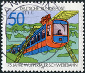 Postage stamp printed in Germany, dedicated to the 75th anniversary of the Wuppertal suspension railroad, is depicted Suspension Train — Stockfoto