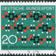 Postage stamp printed in Germany, dedicated to the 125th anniversary of Synthetic textile fiber research, shows a cloth pattern formed of chain molecules — Stock Photo #53121023
