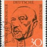 Постер, плакат: Postage stamp printed in Germany shows the first post war German Chancellor Konrad Adenauer