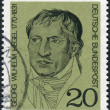 Постер, плакат: Postage stamp printed in Germany shows a German philosopher and a major figure in German Idealism Georg Wilhelm Friedrich Hegel