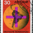 Postage stamp printed in Germany, shows the Cross in front of a globe with the Central and South America — Stock Photo #53122185