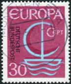 Postage stamp printed in Germany, shows a stylized image of a sailboat, the inscription CEPT — Stock Photo