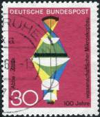 Postage stamp printed in Germany, dedicated to the 100th anniversary of scientific microscope construction — Stockfoto