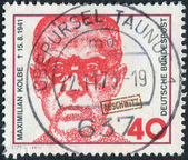 Postage stamp printed in Germany, shows the Maximilian Kolbe, Polish priest who died in Auschwitz and was beatified in 1971 — Stock Photo
