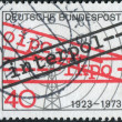 "Postage stamp printed in Germany, dedicated to the 50th anniversary of International Criminal Police Organization, shows the Radio Tower and the inscription ""Interpol"" — Stock Photo #53430765"