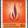 Postage stamp printed in Germany, dedicated to the International human rights year, shows Human rights flame — Stock Photo #53431197
