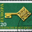 Postage stamp printed in Germany, shows the Golden Key with C.E.P.T. Emblem — Stock Photo #53431615