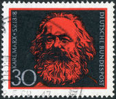 Postage stamp printed in Germany, shows portrait of Karl Heinrich Marx, a German philosopher, economist, sociologist, historian, journalist, and revolutionary socialist — Stock Photo