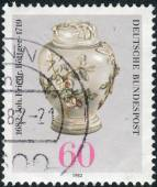 Postage stamp printed in Germany, dedicated to the 300th anniversary of Johann Friedrich Bottger, originator of Dresden china, shown Pear-shaped Pot with Lid — Foto Stock