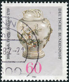 Postage stamp printed in Germany, dedicated to the 300th anniversary of Johann Friedrich Bottger, originator of Dresden china, shown Pear-shaped Pot with Lid — Stockfoto