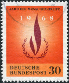 Postage stamp printed in Germany, dedicated to the International human rights year, shows Human rights flame — Stockfoto