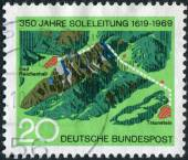 Postage stamp printed in Germany, dedicated to the 350th anniversary of the Brine Pipe Line from Traunstein to Bad Reichenhall — Foto Stock