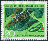 Postage stamp printed in Germany, dedicated to the 350th anniversary of the Brine Pipe Line from Traunstein to Bad Reichenhall — 图库照片