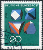 Postage stamp printed in Germany, dedicated to the 1000th anniversary of mining in the Harz Mountains, shows the mineral Galena (top) and Sphalerite (bottom) — Stockfoto