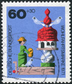 Postage stamp printed in Germany, shows a children's wooden toy of the 19th century, the music box in the form of a dovecote — Stock Photo