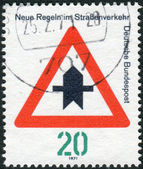 "Postage stamp printed in Germany, dedicated to New traffic rules, shows a road sign ""Proceed with caution"" — Stock Photo"