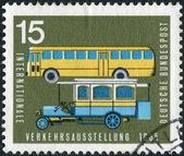 Postage stamp printed in Germany, dedicated to the International Transport and Communications Exhibition, Munich, shows the old and new post buses — Stockfoto