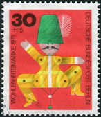 Postage stamp printed in Germany (West Berlin), shows a vintage children's wooden toys, Jumping jack — Photo