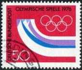 Postage stamp printed in Germany, dedicated to the 12th Winter Olympic Games, Innsbruck, Austria, shows the Olympic Rings, Symbolic Mountains — Stockfoto