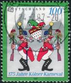 "Postage stamp printed in Germany, dedicated to the 175th anniversary of the Cologne Carnival, shows Carnivalists at the ""Wibbeln"" — Foto Stock"