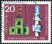 Postage stamp printed in Germany, dedicated to the International Transport and Communications Exhibition, Munich, shows semaphore telegraph and telecommunication tower — Foto Stock