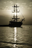 Evening. Sailboat in the bay. Stylization. Toning. Sepia — Stock Photo