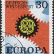 Postage stamp printed in Germany, shows a Cogwheels, and emblem C.E.P.T. — Stock Photo #54343329