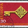 Postage stamp printed in Germany, shows the Golden Key with C.E.P.T. Emblem — Stock Photo #54344053