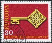 Postage stamp printed in Germany, shows the Golden Key with C.E.P.T. Emblem — Stock Photo