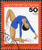Postage stamp printed in Germany, Issue: Youth training for the Olympics, depicts Gymnastics, women's — Stock Photo
