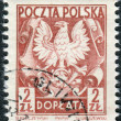 Postage stamp (dues) printed in Poland, shows the coat of arms of on shield — Stock Photo #54590499