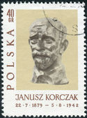 Postage stamp printed in Poland, shows a sculpture of Janusz Korczak by Xawery Dunikowski — Stock Photo