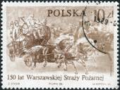 Postage stamp printed in Poland, dedicated to the 150th anniversary of the Warsaw Fire Brigade, shows The Fire Brigade on the Cracow Outskirts on Their Way to a Fire, 1871, by Josef Brodowski — Photo