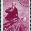Постер, плакат: Postage stamp printed in Romania shows Wladimir Iljitsch Lenin and flag