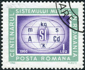 Postage stamp printed in Romania, dedicated to the centenary of the metric system in Romania is shown Metric system symbols — ストック写真