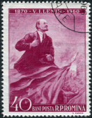 Postage stamp printed in Romania shows Wladimir Iljitsch Lenin and flag — Stock Photo