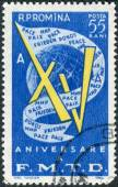 Postage stamp printed in Romania, dedicated to the Fifteenth Anniversary of World Federation of Democratic Youth, shows Globe and flag with inscription — Stock fotografie
