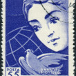 Postage stamp printed in Romania, dedicated to the 50th anniversary of International Women's Day, shows Woman's face, peace dove and globe — Stock Photo #54911561