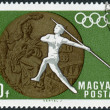 Postage stamp printed in Hungary, devoted to 19th Summer Olympics, Mexico City in 1968, shows the Olympic Medal and Women's Javelin — Stock Photo #55020127